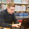 Globe/Roger Nomer<br /> Shane Robison, an Ozark Christian College senior from New Albany, Ind., studies on Thursday in the OCC library.