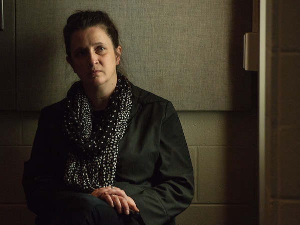Globe/Roger Nomer<br /> Christine Bentley, gallery director for the Missouri Southern Spiva Gallery, watches an emotional slideshow of Orjan Henriksson's work from Auschwitz during a presentation on Monday at MSSU.