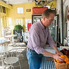 Globe/Roger Nomer<br /> Scott Nelson stocks fruit on Monday at Nelson's Old Riverton Store in Riverton.