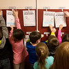 Globe/Roger Nomer<br /> Students hang books they wrote about polar bears during kindergarten on Thursday at Kelsey Norman Elementary.