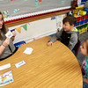 Globe/Roger Nomer<br /> Katie Hadley practices words with Xander Rainey and Caitlynn Hayden during kindergarten on Thursday at Kelsey Norman Elementary.