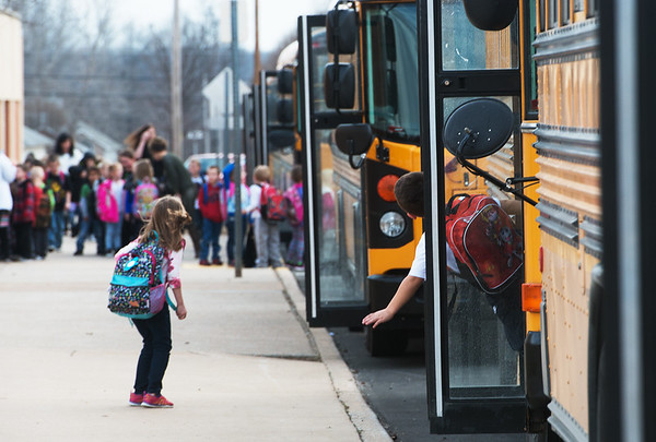 Globe/Roger Nomer<br /> Carl Junction students board busses on Monday afternoon.