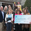 Globe/Roger Nomer<br /> (front row from right) Mark VonMoss, president of the National Association of Insurance and Financial Advisors of Southwest Missouri, and Linda Teeter, NAIFA-MO community service chair, present Annette Thurston, executive director of the Ronald McDonald House of the Four States, with a check for $300 to sponsor 30 nights for families staying at the house. Also pictured in the front row is Della Croft, co-owner of Joplimo Mattress, who partnered with the NAIFA-MO to donate 36 mattress pads to the house, totaling over $3,000.