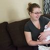 Globe/Roger Nomer<br /> Alex Duke cradles her daughter Kyndall Clarkson at the family's home in Pittsburg on Thursday.