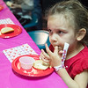 Globe/Roger Nomer<br /> Paislee Jones, 2, Webb City, samples her cookie creation during an early Valentine's Day event at Roller City Skate and Play of Joplin on Thursday.