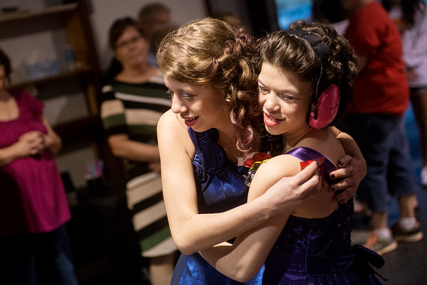 Globe/Roger Nomer<br /> Abi Clayton, 14, Adrian, left, greets Payton Littlejohn, 13, Lamar, during Saturday's Joy Prom in Lamar