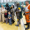 Kaylee Braeckel, 8 and Logan Braeckel, 5, both of Carl Junction, pose for photos with Star Wars characters on Saturday at Leggett & Platt during Missouri Southern basketball.<br /> Globe | Laurie Sisk