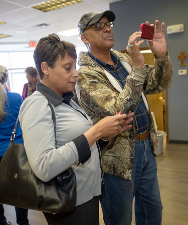 Jodi Evans, left and jim West take photographs of a plaque honoring Joplin healthcare pioneer and Community Clinic founding board member Doris Carson on Friday at the clinic. Evans is Carson's granddaughter and West grew up with Carson as his babysitter.<br /> Globe | Laurie Sisk