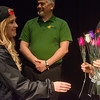 Globe/Roger Nomer<br /> Kenna Laidler, a Pittsburg State junior from Frontenac, gives a rose to Yoko Teats following a presentation on Wednesday at Pittsburg State.
