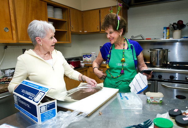 From the left: Judy Turner and Barb Majzoub prepare food Tuesday afternoon for the Shrove Tuesday Shrimp Dinner on Tuesday night at St. Philip's Episcopal Church. Workers prepared shrimp, chicken, red beans and rice and more for about 100 guests. Proceeds from the event will benefit the outreach program at St. Philip's.<br /> Globe | Laurie SIsk