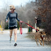 Globe/Roger Nomer<br /> Kelly Johnson runs with Ashlee on Tuesday on the Frisco Trail.