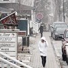 BEN GARVER — THE BERKSHIRE EAGLE<br /> A woman walks along Church Street in Lenox as snow begins to fall, Friday, April 6, 2018.