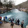 Anglers crowd the banks of Roaring River during opening day of trout season in Cassville on Sunday.<br /> Globe | Roger Nomer