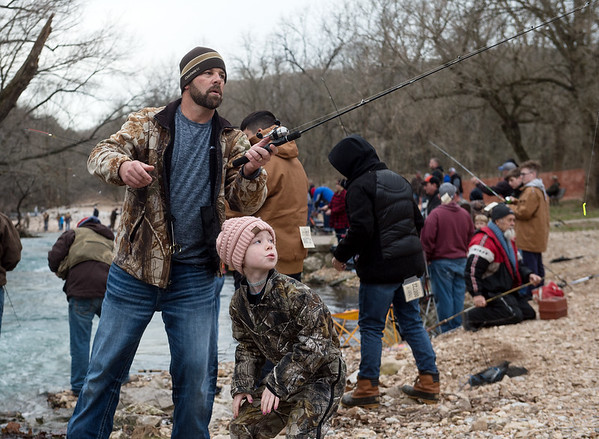 Six-year old Hazley Dutra ducks as her father Jerony casts her line on Sunday at Roaring River State Park.<br /> Globe   Roger Nomer