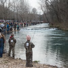 Anglers crowd the banks of Roaring River on Sunday for the first day of trout fishing season at Roaring River State Park.<br /> Globe | Roger Nomer