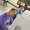 Carole and Keith Harrington vote at the Miami Civic Center on Tuesday afternoon.<br /> Globe | Roger Nomer