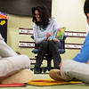"""Kim Rogers, associate professor in the department of dental hygiene at Missouri Southern State University, reads """"The Tooth Book"""" to children at the Lion Cub Academy on Monday as part of the Read Across America event. The Academy is planning on having 100 MSSU faculty and staff members read to the children over the week.<br /> Globe 