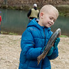 Seven-year old Miller Rogers, Springfield, admires his catch on Sunday at Roaring River State Park.<br /> Globe | Roger Nomer
