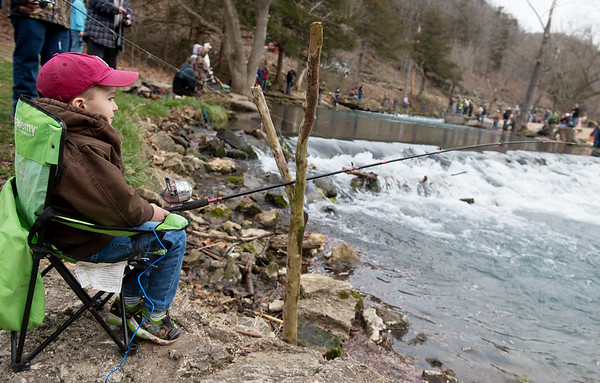 Four-year old Jace Still, Rocky Comfort, uses a stick to help him support his pole while fishing at Roaring River State Park on Sunday.<br /> Globe | Roger Nomer