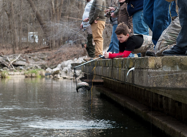 Eight-year old Keegan Horner, Diamond, pulls a fish from Roaring River during opening day at the state park on Sunday.<br /> Globe   Roger Nomer