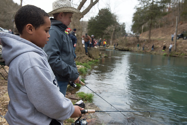 Malachi Rash (left), 8, and Jacob Farber, 12, from Mustang, Okla., fish at Roaring River State Park on Sunday.<br /> Globe | Roger Nomer