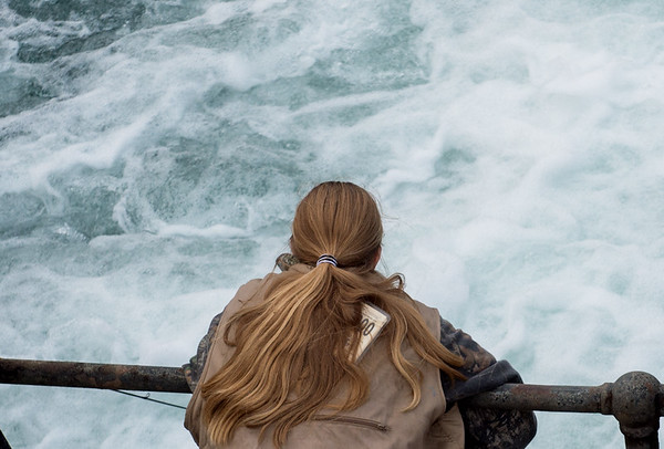 Sixteen-year old Hannah Belcher, Lamar, fishes at the falls of Roaring River during opening day of trout season on Sunday.<br /> Globe | Roger Nomer