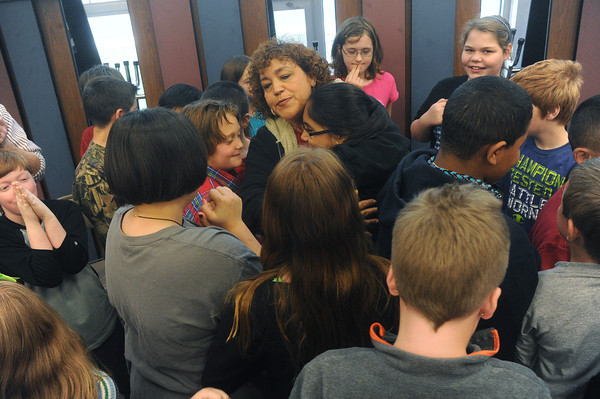 Globe/Roger Nomer<br /> Students gather around Lourdes Hasty to welcome her back to Stapleton Elementary on Monday morning.