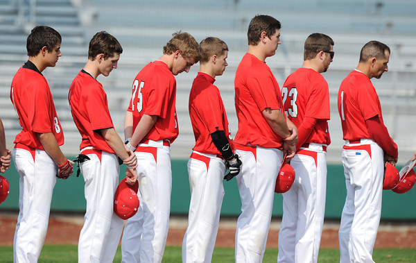 Globe/Roger Nomer<br /> Members of the Carl Junction High School baseball team join the stadium in a moment of silence for the victims of the Boston Marathon attack before Monday's game against Joplin at the Joplin Athletic Complex.