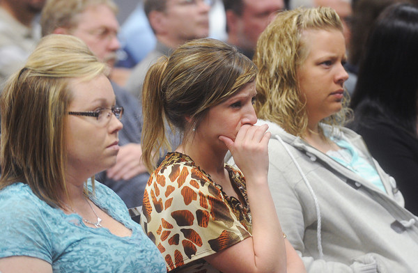 Globe/Roger Nomer<br /> Con-way employees (from left) Tabitha Gibson, Keri Bard and Amanda Tinney watch a Missouri State Highway Patrol video about the consequences of distracted and impaired driving during Tuesday's presentation.