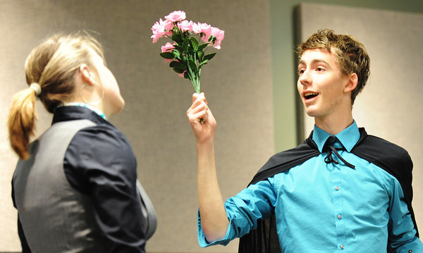 """Globe/T. Rob Brown<br /> Cole Crutcher, portraying a magician during Branson High School's """"Air France"""" skit, pulls a bouqet of flowers out of his hat for Taylor Johnston during French language skit competitions Thursday morning, April 11, 2013, in Missouri Southern State University's Phelp's Theater in Billingsly Student Center."""