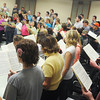 """Globe/Roger Nomer<br /> Members of The Southern Symphonic Chorus practice Maurice Durufle's """"Requiem"""" on Monday evening."""