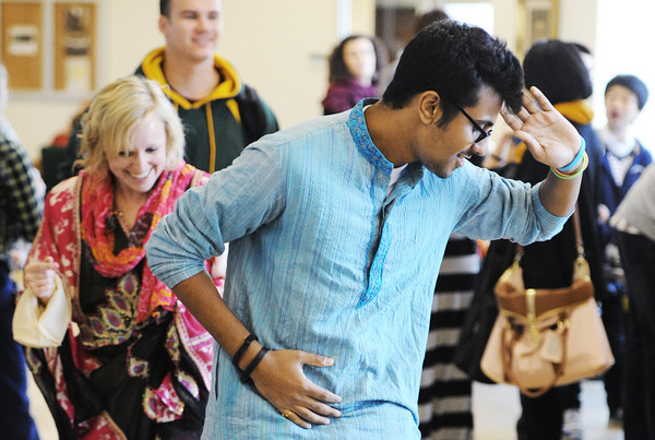 Globe/T. Rob Brown<br /> Addy Malhotra (center), an MSSU freshman marketing major born in India and raised in Africa, demonstrates an Indian dance as Lora Dean (left), of Joplin, MSSU coordinator of International Missions, follows in his dancesteps Thursday afternoon, April 11, 2013, in Billingsly Student Center. The dance demonstration was part of the university's International Expo for Diversity Week.