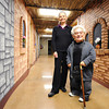 Globe/T. Rob Brown<br /> Lowell and Judy Mason, of Carl Junction, in a recently decorated hallway at their church.