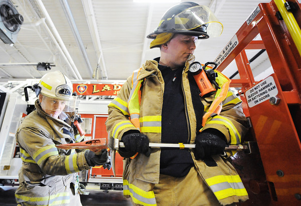Globe/T. Rob Brown<br /> Capt. Joe Huddleston hits a metal tool held by firefighter-EMT Ben Phillips as they practice an emergency forced entry Wednesday afternoon, April 3, 2013, at the Joplin Fire Department, Station No. 1, in downtown Joplin.