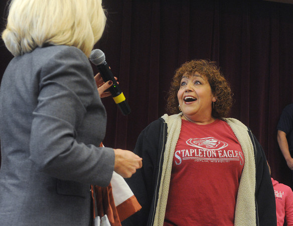 Globe/Roger Nomer<br /> Lourdes Hasty lights up with surprise as Stapleton Principal Robyn Mitchell tells her about the school's art auction to raise money for Hasty's recovery costs.