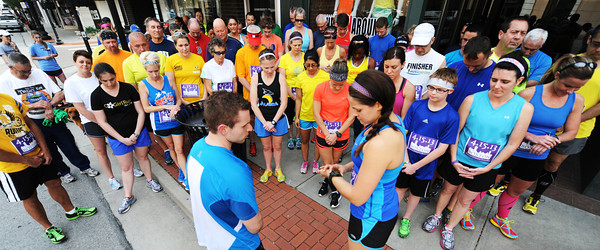 Globe/T. Rob Brown<br /> Local runners begin 144 seconds of silence to honor those injured in the Boston bombing.