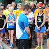 Globe/T. Rob Brown<br /> Erik and Cathy Bartlett, owners of The Run Around Running Co., hold 144 seconds of silence in downtown Joplin Wednesday evening, April, 17, 2013. The event's intent was to support those injured in the Boston bombing.