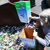 Globe/T. Rob Brown<br /> Betsy Eighmy, of Loma Linda, dumps a load of food cans into the recycle bins at the Joplin Recycling Center Friday morning, April 5, 2013.