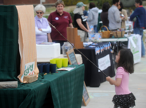 Globe/Roger Nomer<br /> Whitley Schroeder, 4, Joplin, goes fishing for a prize at the Every Day Earth Day celebration at Suzanne's Natural Foods on Saturday.