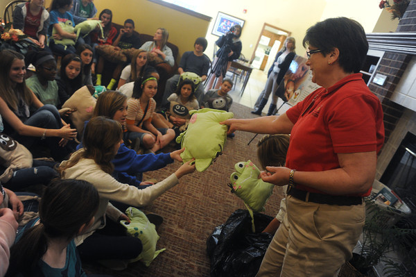 Globe/Roger Nomer<br /> Shirley Hylton, manager of the Ronald McDonald House of the Four States, admires the handiwork of sewing students from the 8th grade at South Middle School.  The students made and delivered pillow pets for the families staying at the Ronald McDonald House on Friday afternoon.