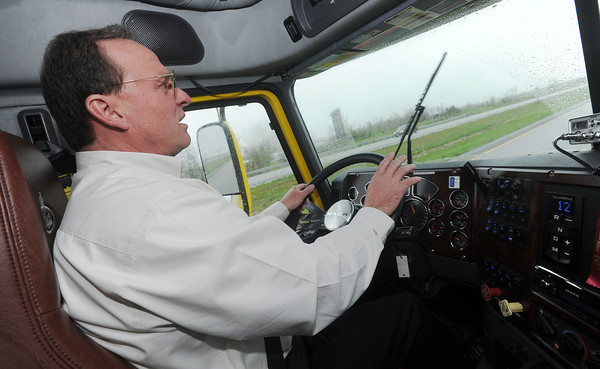 Globe/Roger Nomer<br /> David May, a captain for America's Road Team, demonstrates truck driving on Tuesday morning.