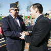 Globe/Roger Nomer<br /> Former Staff Sergeant Clinton Romesha shakes hands with Jerry Waltrip, Pittsburg, following Thursday's ceremony at the Veteran's Memorial.