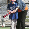Globe/Roger Nomer<br /> Janel Harding helps her son Hayden, 7, with his swing at the Will Norton Miracle Field on Wednesday.