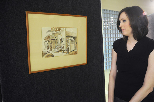 Globe/Roger Nomer<br /> Jessica Lingenfelter, gallery and events coordinator for the Longwell Museum at Crowder College, looks at a pen and ink drawing by Thomas Hart Benton on Friday morning.