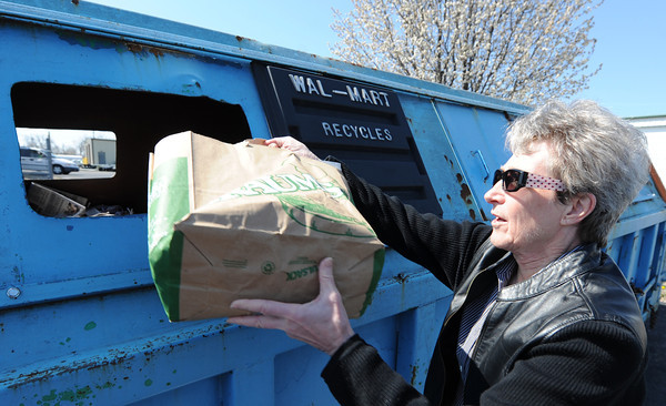 Globe/T. Rob Brown<br /> Dianne Ray, of Joplin, dumps a bag load of newspapers into the recycle bins at the Joplin Recycling Center Friday morning, April 5, 2013.