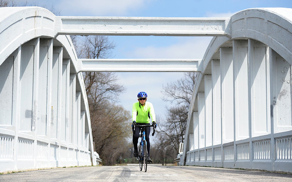 Globe/T. Rob Brown<br /> John Robb, a Pittsburg, Kan., cyclist, rides across the Rainbow Bridge on Route 66 near Baxter Springs, Kan., Monday afternoon, April 1, 2013.