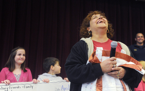 Globe/Roger Nomer<br /> Lourdes Hasty gathers herself before addressing the crowd at Stapleton Elementary during her welcome back assembly on Monday morning.