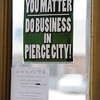 Globe/T. Rob Brown<br /> Signs like this can be seen all around downtown Pierce City Thursday morning, April 25, 2013.