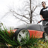Globe/T. Rob Brown<br /> 'Tis the Season: Josh Marsh mows the front yard of his Joplin home Monday afternoon, April 8, 2013, near the intersection of 7th Street and Empire Avenue.
