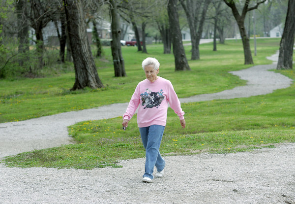 Globe/Roger Nomer<br /> Barbara Weakley exercises at Walton Park in Nevada on Wednesday morning.  The Healthy Nevada initiative wants to bring more walking trails like this one to the city.